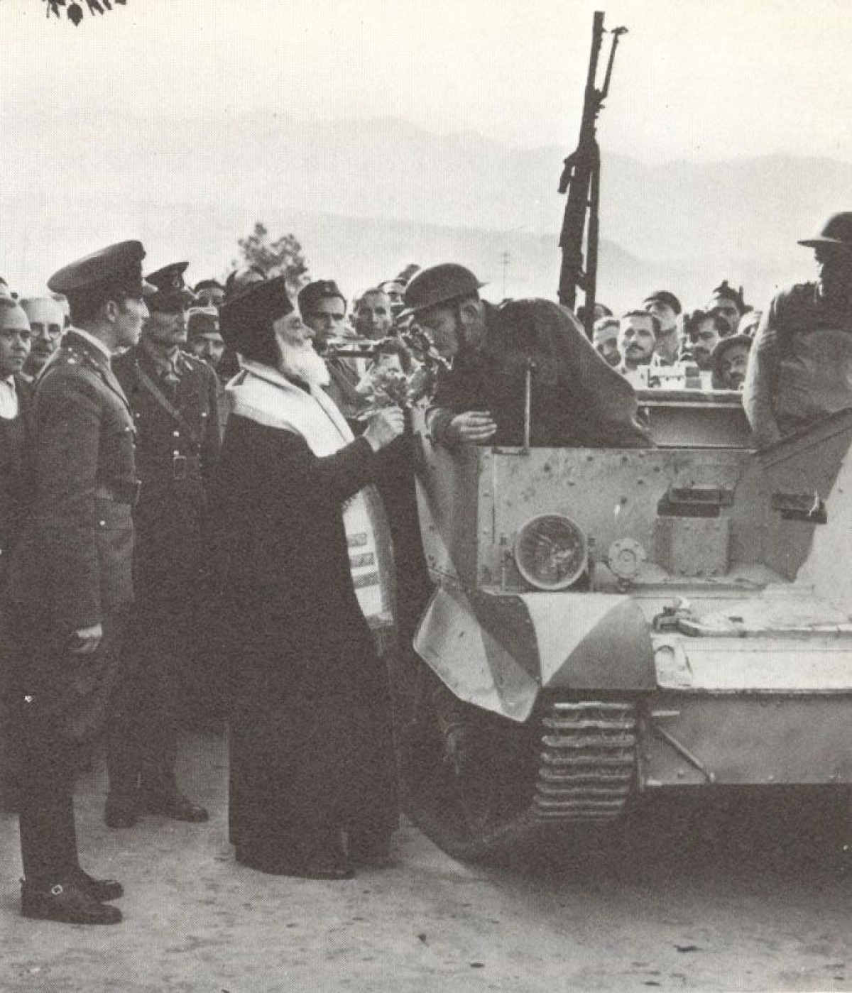 The Greek Orthodox Bishop of Canea (Crete) blesses British troops. In front is a Bren Gun carrier
