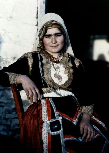 A woman poses in the national costume of Crete 1920's Images by Maynard Owen Williams Wilhelm Tobien